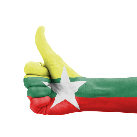 Hand with thumb up, Myanmar flag painted as symbol of excellence, achievement, good - isolated on white background photo