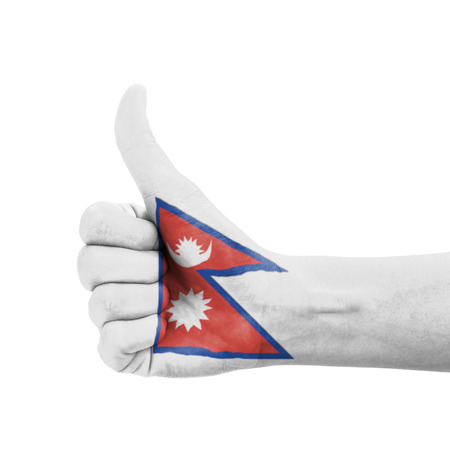 Hand with thumb up, Nepal flag painted as symbol of excellence, achievement, good - isolated on white background photo