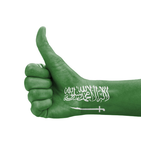 Hand with thumb up, Saudi Arabia flag painted as symbol of excellence, achievement, good - isolated on white background photo
