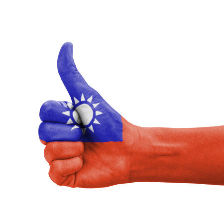 Hand with thumb up, Taiwan flag painted as symbol of excellence, achievement, good - isolated on white background photo