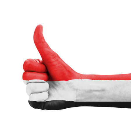 Hand with thumb up, Yemen flag painted as symbol of excellence, achievement, good - isolated on white background photo