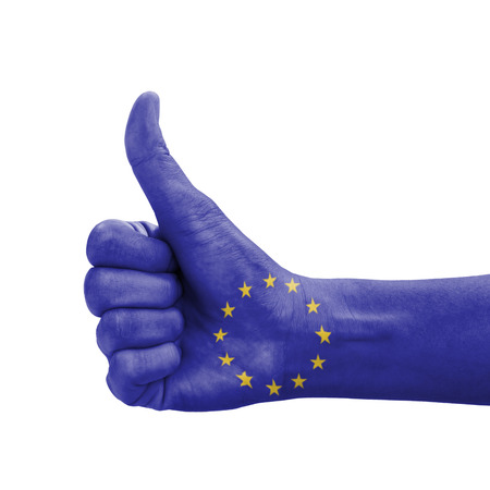 Hand with thumb up, EU (European Union) flag painted as symbol of excellence, achievement, good - isolated on white background photo