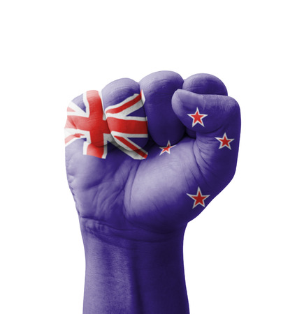 Fist of New Zealand flag painted, multi purpose concept - isolated on white background Stock Photo