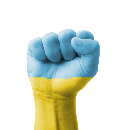 Fist of Ukraine flag painted, multi purpose concept - isolated on white background photo