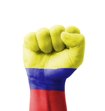 Fist of Colombia flag painted, multi purpose concept - isolated on white background photo
