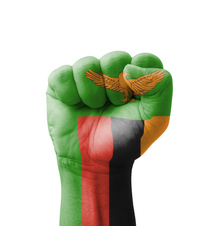 Fist of Zambia flag painted, multi purpose concept - isolated on white background Stock Photo