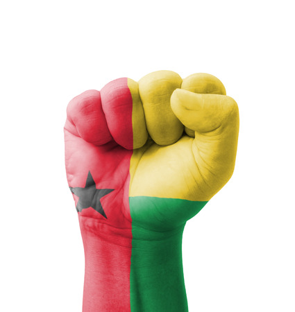 guinea bissau: Fist of Guinea-Bissau flag painted, multi purpose concept - isolated on white background Stock Photo