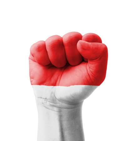 national flag indonesian flag: Fist of Indonesia flag painted, multi purpose concept - isolated on white background Stock Photo