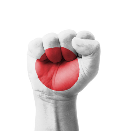 Fist of Japan flag painted, multi purpose concept - isolated on white background photo