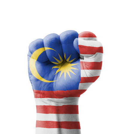 Fist of Malaysia flag painted, multi purpose concept - isolated on white background