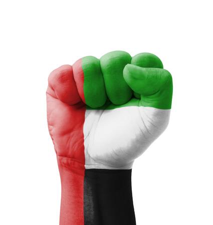 Fist of UAE (United Arab Emirates) flag painted, multi purpose concept - isolated on white background photo