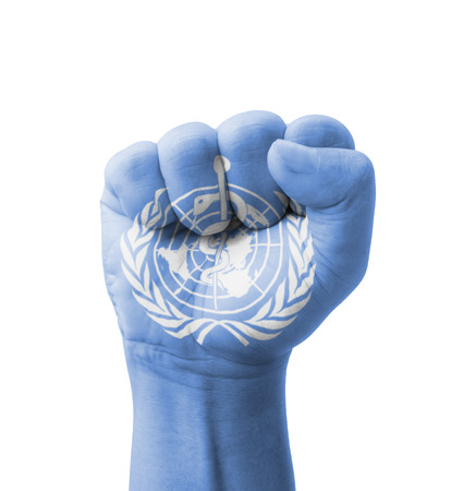 Fist of WHO (World  Health  Organization) flag painted, multi purpose concept - isolated on white background Stock Photo