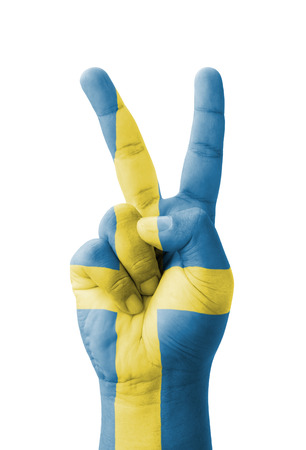 Hand making the V sign, Sweden flag painted as symbol of victory, win, success - isolated on white background
