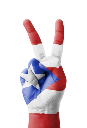 Hand making the V sign, Puerto Rico flag painted as symbol of victory, win, success - isolated on white background photo