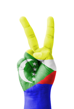 comoros: Hand making the V sign, Comoros flag painted as symbol of victory, win, success - isolated on white background