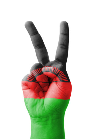 malawi flag: Hand making the V sign, Malawi flag painted as symbol of victory, win, success - isolated on white background