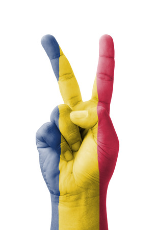 Hand making the V sign, Chad flag painted as symbol of victory, win, success - isolated on white background Stock Photo