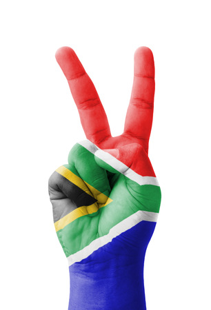 Hand making the V sign, South Africa flag painted as symbol of victory, win, success - isolated on white background photo