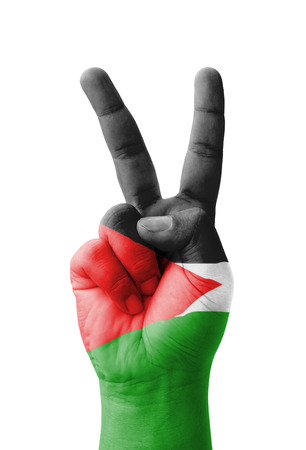Hand making the V sign, Palestine flag painted as symbol of victory, win, success - isolated on white background