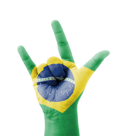 Hand making I love you sign, Brazil flag painted, multi purpose concept - isolated on white background photo