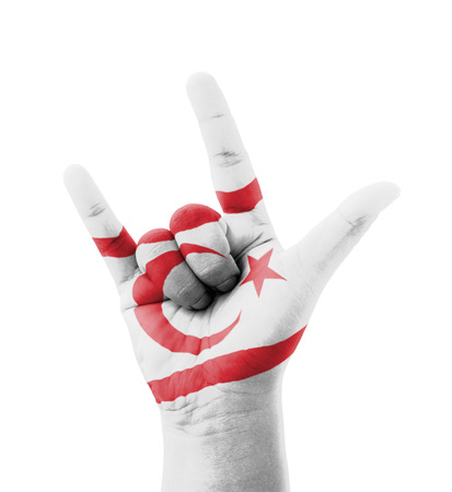 Hand making I love you sign, Northern Cyprus flag painted, multi purpose concept - isolated on white background photo
