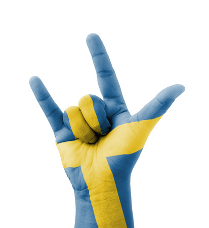 Hand making I love you sign, Sweden flag painted, multi purpose concept - isolated on white background photo