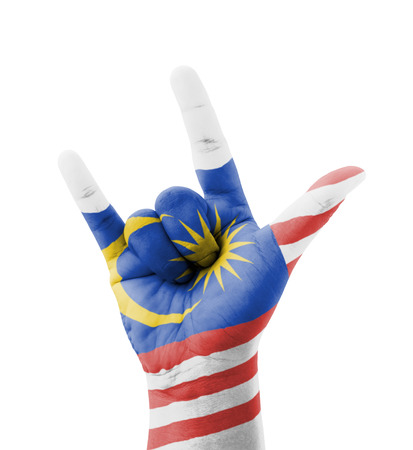 Hand making I love you sign, Malaysia flag painted, multi purpose concept - isolated on white background photo