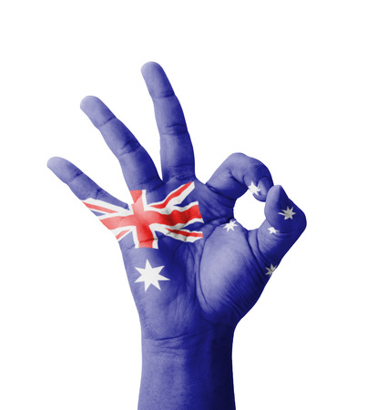 Hand making Ok sign, Australia flag painted as symbol of best quality, positivity and success - isolated on white background photo