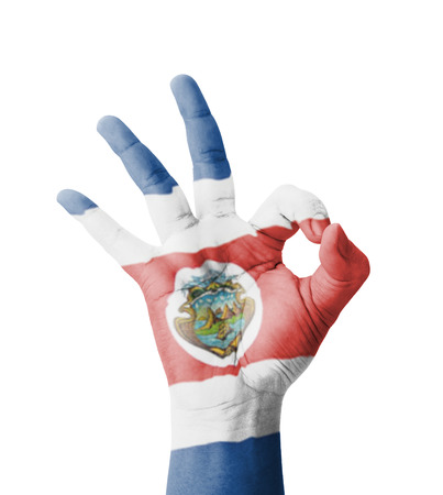 Hand making Ok sign, Costa Rica flag painted as symbol of best quality, positivity and success - isolated on white background photo