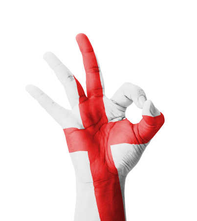 Hand making Ok sign, England flag painted as symbol of best quality, positivity and success - isolated on white background photo