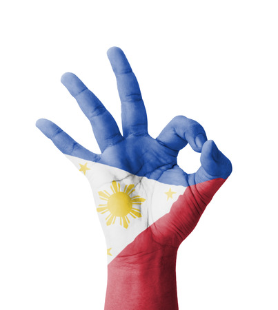 Hand making Ok sign, Philippines flag painted as symbol of best quality, positivity and success - isolated on white background photo