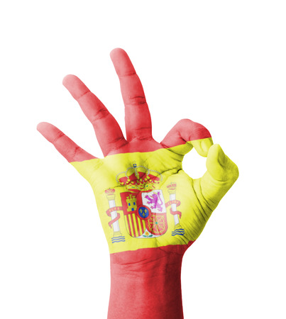 Hand making Ok sign, Spain flag painted as symbol of best quality, positivity and success - isolated on white background photo