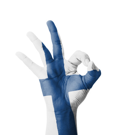 Hand making Ok sign, Finland flag painted as symbol of best quality, positivity and success - isolated on white background photo