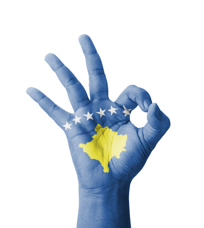 Hand making Ok sign, Kosovo flag painted as symbol of best quality, positivity and success - isolated on white background photo