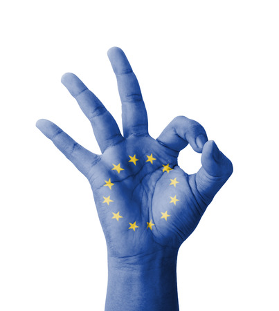 Hand making Ok sign, EU (European Union) flag painted as symbol of best quality, positivity and success - isolated on white background