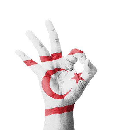 Hand making Ok sign, Northern Cyprus flag painted as symbol of best quality, positivity and success - isolated on white background photo