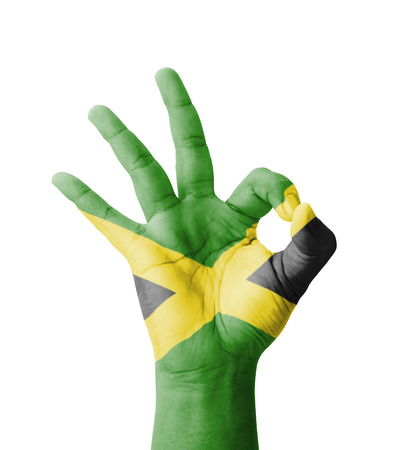 jamaica: Hand making Ok sign, Jamaica flag painted as symbol of best quality, positivity and success - isolated on white background Stock Photo