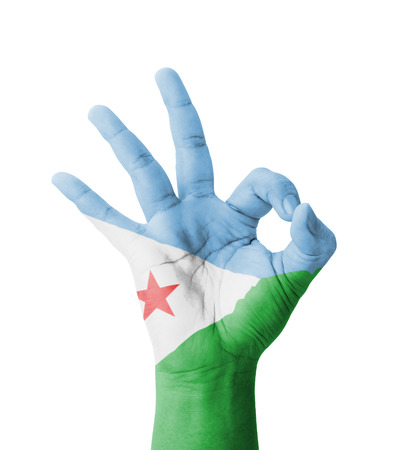 Hand making Ok sign, Djibouti flag painted as symbol of best quality, positivity and success - isolated on white background Stock Photo