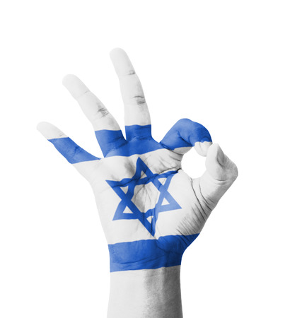 Hand making Ok sign, Israel flag painted as symbol of best quality, positivity and success  photo