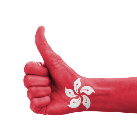 Hand with thumb up, Hong Kong flag painted as symbol of excellence, achievement, good  photo