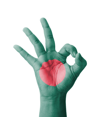 Hand making Ok sign, Bangladesh flag painted as symbol of best quality, positivity and success photo