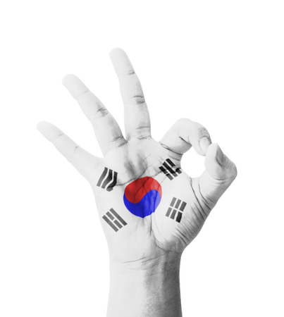 Hand making Ok sign, South Korea flag painted as symbol of best quality, positivity and success photo