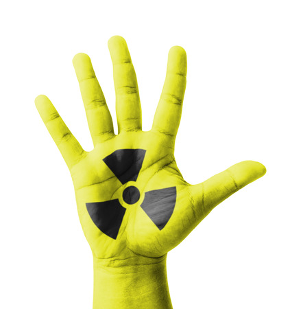 Open hand raised, Nuclear sign painted, multi purpose concept - isolated on white background photo