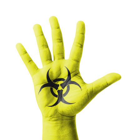 Open hand raised, Biohazard sign painted, multi purpose concept - isolated on white background photo