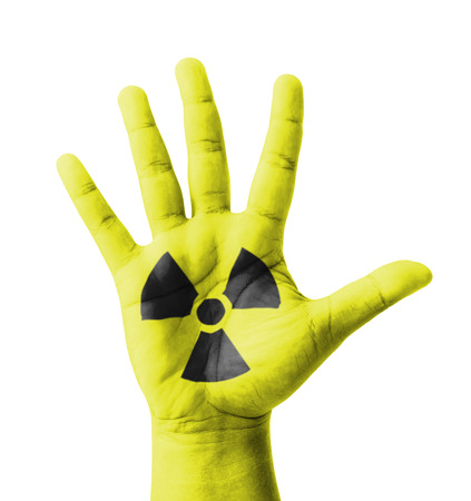 Open hand raised, Radioactivity sign painted, multi purpose concept photo