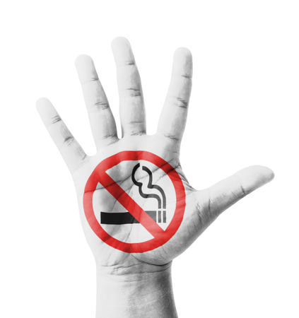 Open hand raised, No Smoking sign painted, multi purpose concept - isolated on white background photo