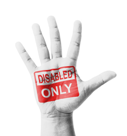 decrepitude: Open hand raised, Disabled Only sign painted, multi purpose concept - isolated on white background