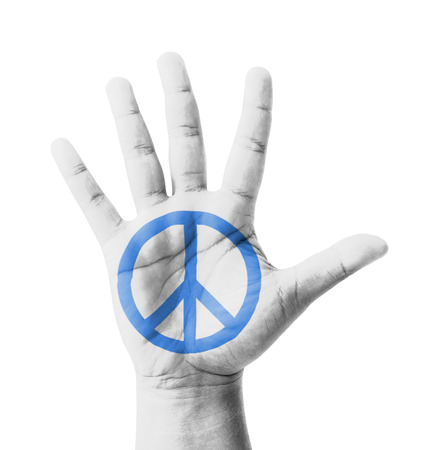 Open hand raised, Peace sign painted, multi purpose concept - isolated on white background photo