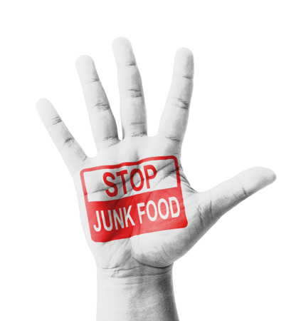 no cholesterol: Open hand raised, Stop Junk Food sign painted, multi purpose concept - isolated on white background