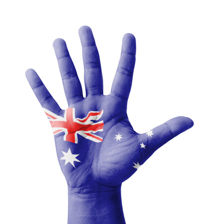 Open hand raised, multi purpose concept, Australia flag painted - isolated on white background photo